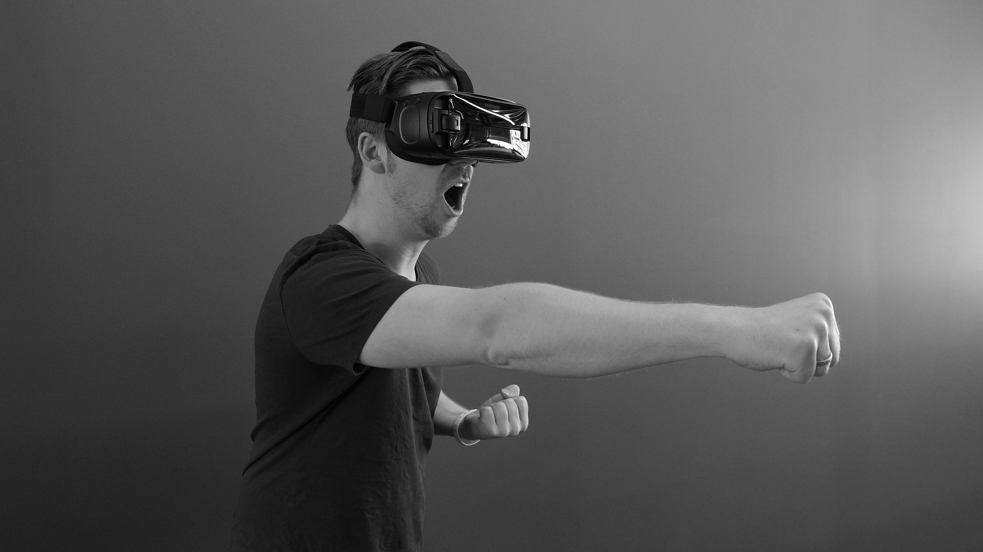 Man using Virtual Reality VR, wearing headset